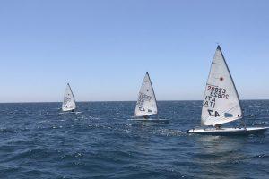 Laseres versenyzőink két napon és négy futamon vannak túl a portugáliai Laser 4.7 EB-n